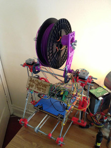A finished, home-made RepRap self replicating printer. The purple parts were 3-D printed and added. (Dino Belsagic/VOA)