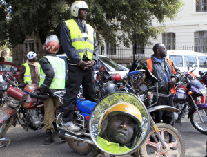 FILE - Kenyan motorcyclists park along a main street to protest over what they say is harassment by the City Council of Nairobi inspectors on traffic offenses within the capital. (Reuters)