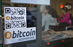 Signs on window advertise a bitcoin ATM machine in a Waves Coffee House in Vancouver, British Columbia , Canada, Oct. 28, 2013. (Reuters)