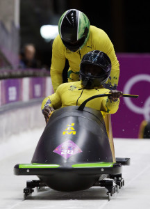 The team from Jamaica JAM-1, piloted by Winston Watts and brakeman Marvin Dixon, start their third run during the men's two-man bobsled competition at the 2014 Winter Olympics, Feb. 17, 2014, in Krasnaya Polyana, Russia. (AP)