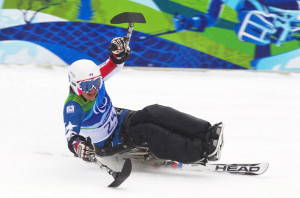 FILE - Alana Nichols of the U.S. celebrates her first place finish in the women's alpine skiing giant slalom sitting event at the 2010 Paralympic Winter Games in Whistler, British Columbia. (Reuters)