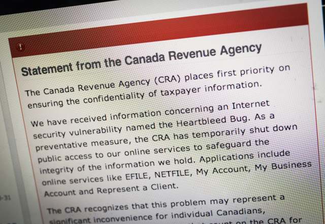"The Canada Revenue Agency website is seen on a computer screen displaying information about an internet security vulnerability called the ""Heartbleed Bug"" in Toronto. (Reuters)"