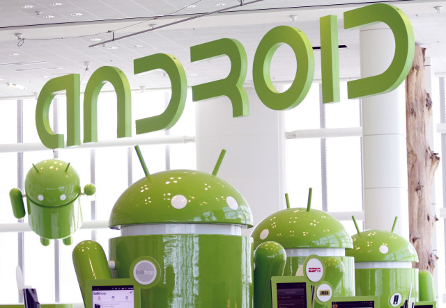 FILE - Android mascots are lined up in the demonstration area at the Google's I/O Developers Conference in San Francisco, California, May 10, 2011. (Reuters)