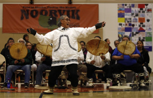 Morris Oviok performs with the Tikigiq Traditional Dancers from Point Hope, Alaska during the Potlach festival in the remote Inupiaq Eskimo village Noorvik, Alaska, Jan 25, 2010. (AP)