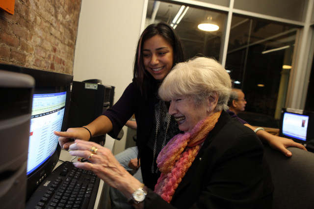 A Nov. 2012 file photo shows an instructor helping a student learn more about using email at the Senior Planet Exploration Center, the first of its kind for free technology education for older adults, NY. (OATS/Michael Kamber)