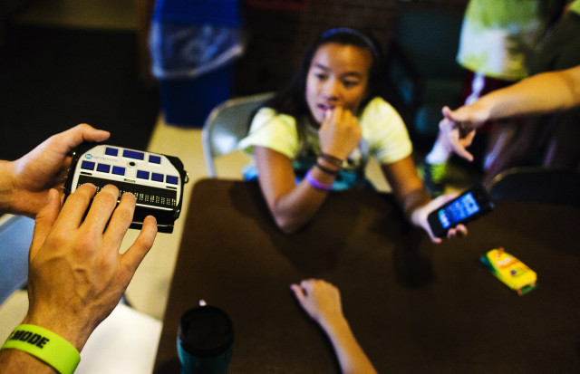 A child uses a Braille machine to type on his iPhone at Camp Abilities in Brockport, New York, June 25, 2013. (Reuters)