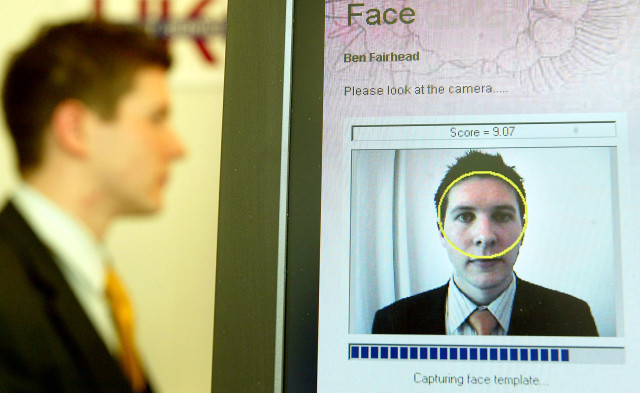 A British Passport Office volunteer has his face scanned for a biometrics enrollment card in London, April 26, 2004. (Reuters)