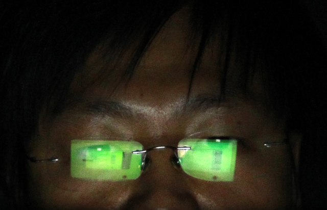 A hacker works on his laptop in his office in Taipei, in Taiwan, July 10, 2013. (Reuters)