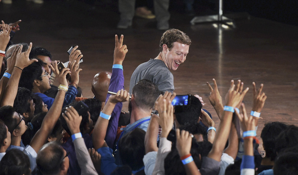 Facebook's CEO Mark Zuckerberg interacts with technology students in a town hall-style meeting in New Delhi, Oct. 28, 2015. During his second visit to India, Zuckerberg rejected criticism that his free Internet access platforms are a luxury for people who cannot afford it. (AP)