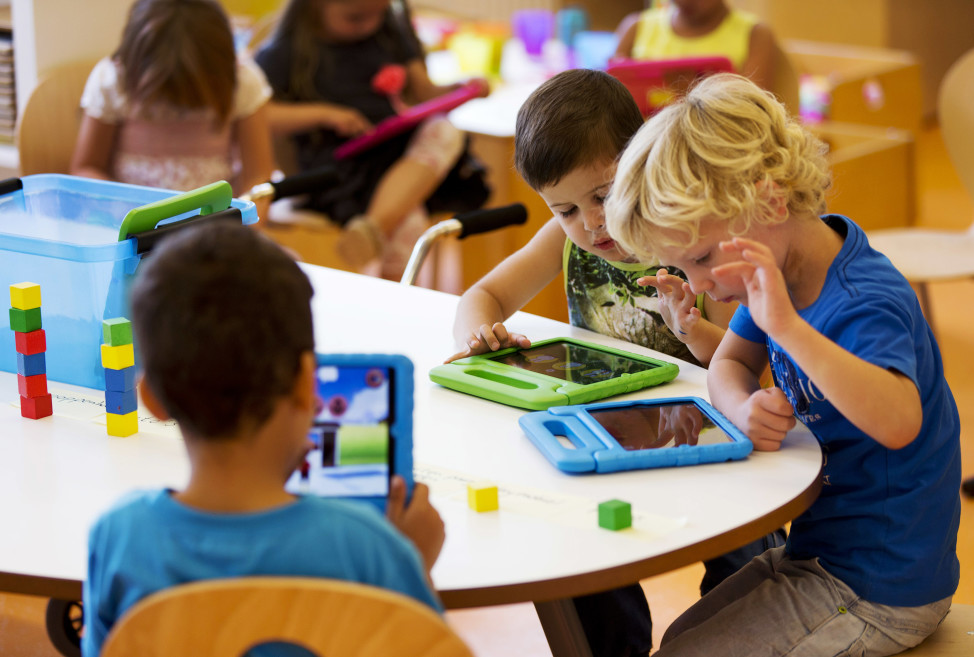 FILE - Children play with their iPads at the Steve Jobs school Sneek, the Netherlands. (Reuters)