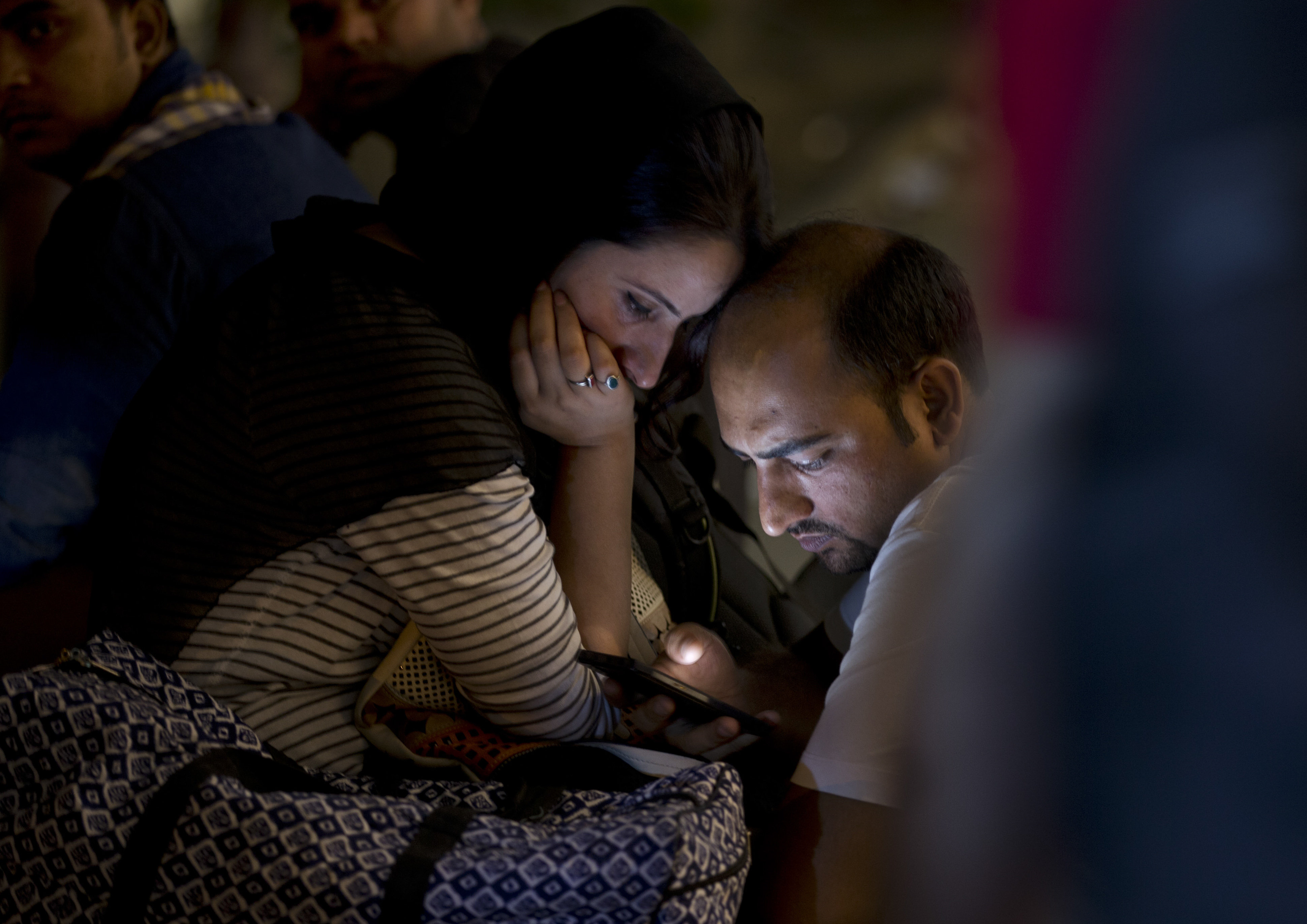 Indians use a mobile phone at a market area in New Delhi, Sept. 27, 2015, following a rare visit to Silicon Valley by Indian Prime Minister Narendra Modi.