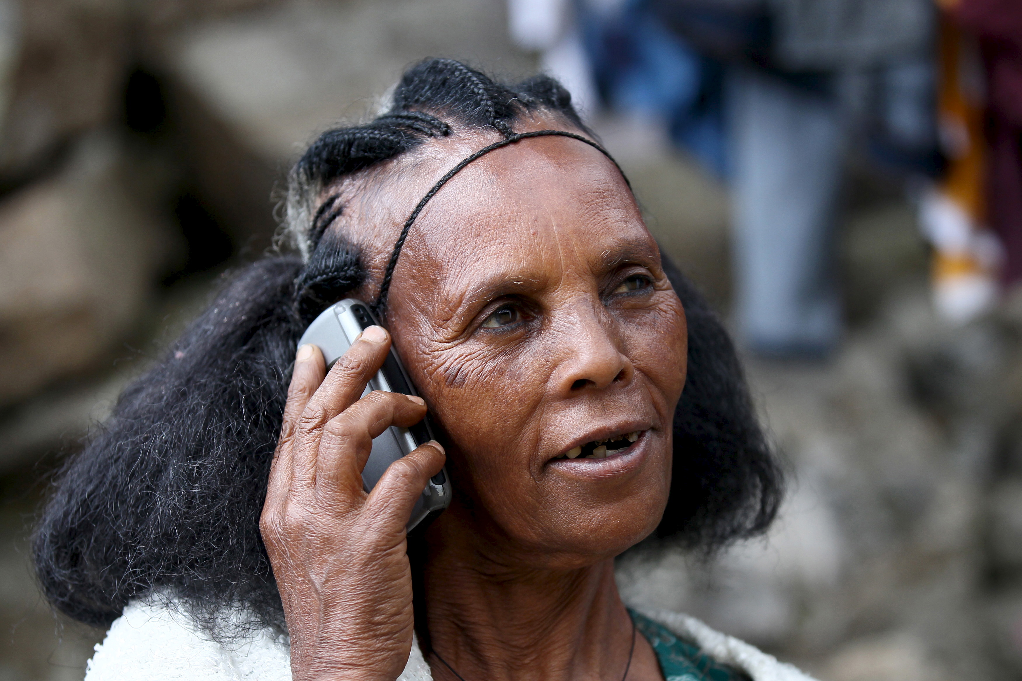 A woman makes a call on her mobile phone in Ethiopia's capital, Addis Ababa, Nov. 9, 2015. Ethiopia's state-run telecoms monopoly will launch a tender in December or January to help the company upgrade infrastructure and expand its mobile phone coverage by about 72 percent, the company's chief executive said. (Reuters)