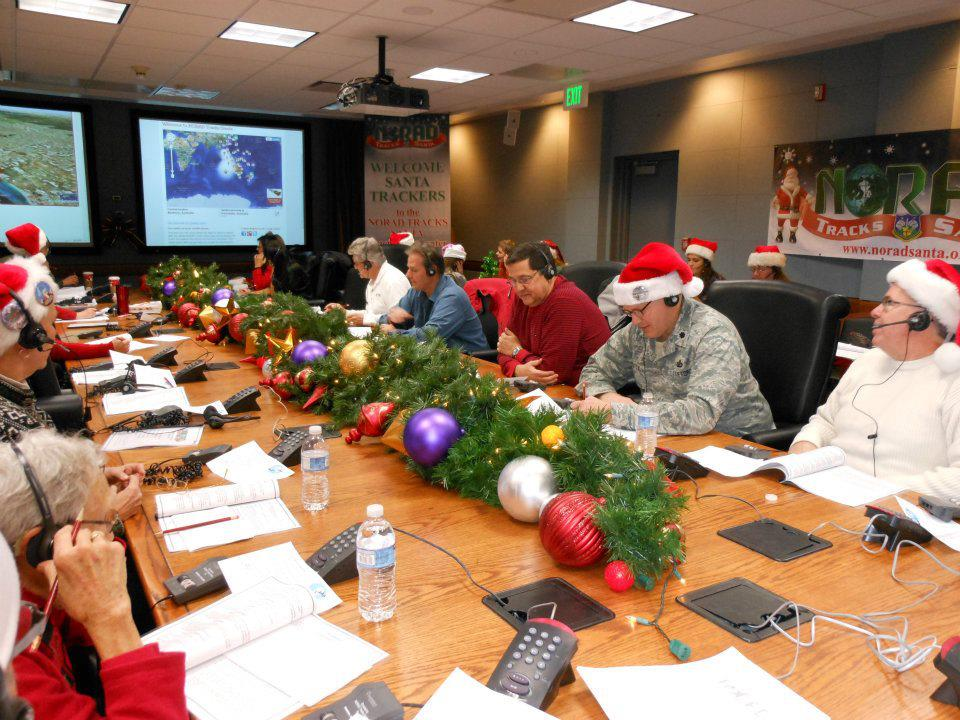 Volunteers at NORAD's Operations Center take calls from people interested in tracking Santa during his 2014 Christmas travels. (NORAD Public Affairs)