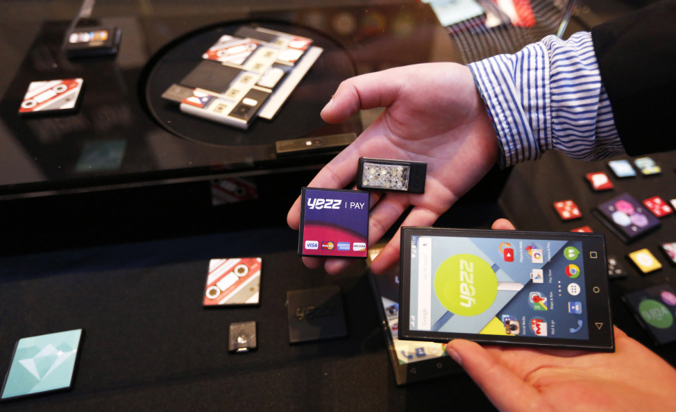 FILE - Prototype modular parts created by Yezz Mobile for Project Ara, Google's modular smartphone project, are shown during the Mobile World Congress in Barcelona, Spain, March 1, 2015. Google's Project Ara is a development effort to create a modular smartphone ecosystem. (Reuters)