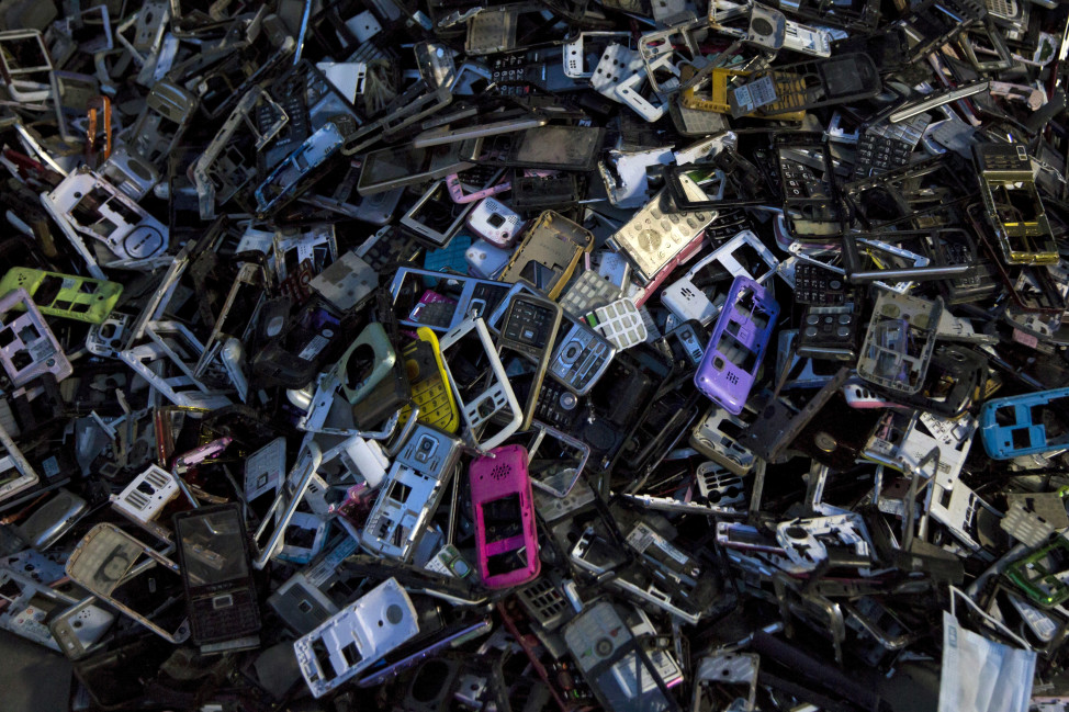 Old cellular phone components are discarded inside a workshop in the township of Guiyu in China's southern Guangdong province, June 10, 2015. (Reuters)