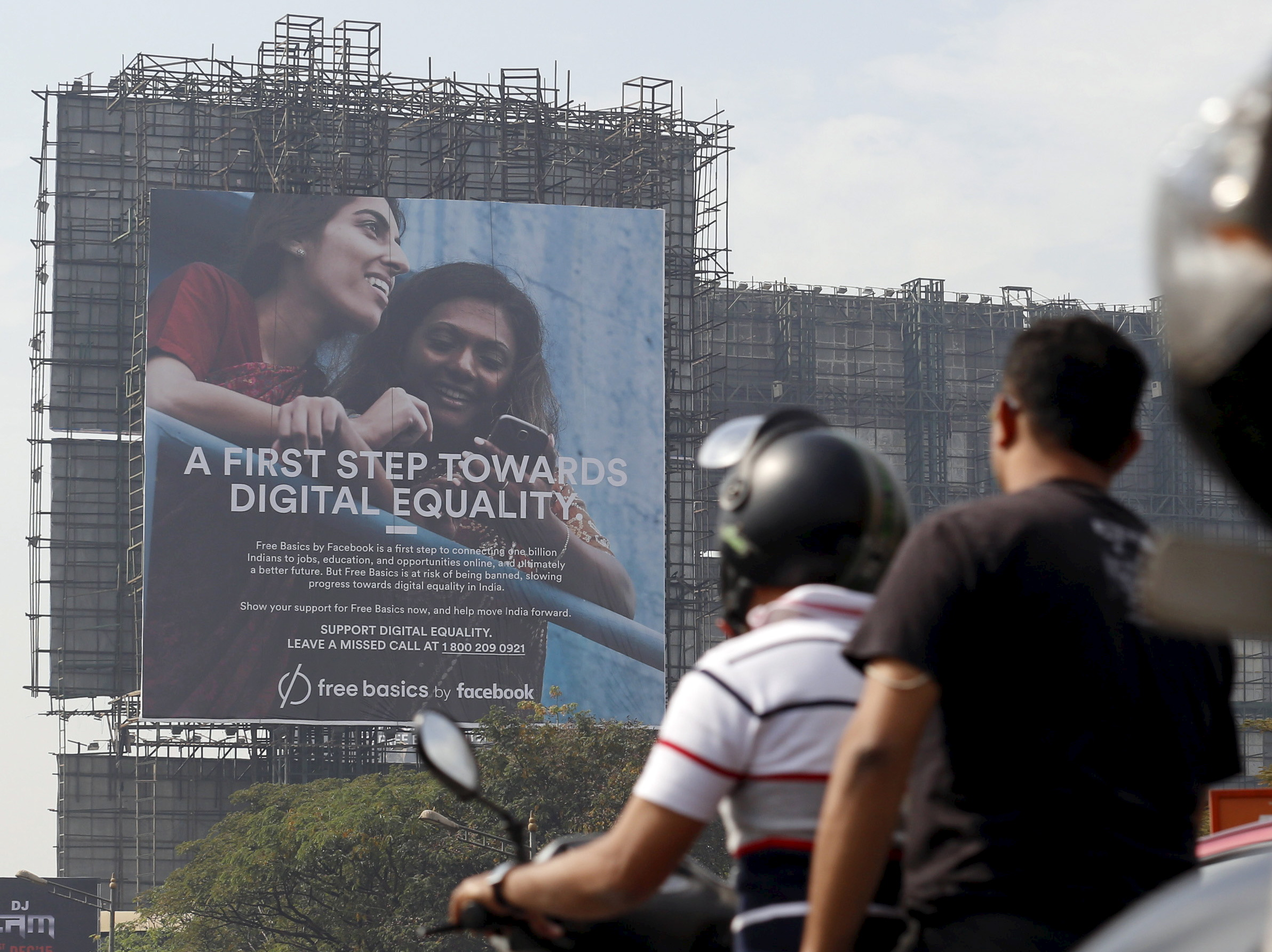 Motorists ride past a billboard displaying Facebook's Free Basics initiative in Mumbai, India, Dec. 30, 2015. Egypt became the second country to temporarily ban the app on Wednesday. (Reuters)
