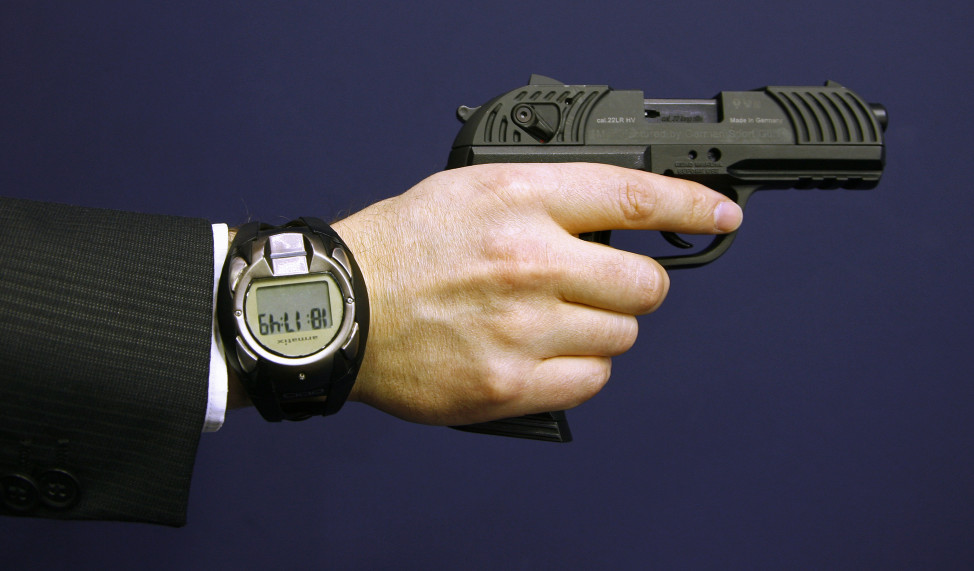 FILE - A man holds a prototype of a smart gun by Armatix in Nuremberg, Germany. The smart gun, the first of its kind, has a fingerprint recognition security system and can only be unblocked if its owner is recognized by a compatible security watch. (Reuters)