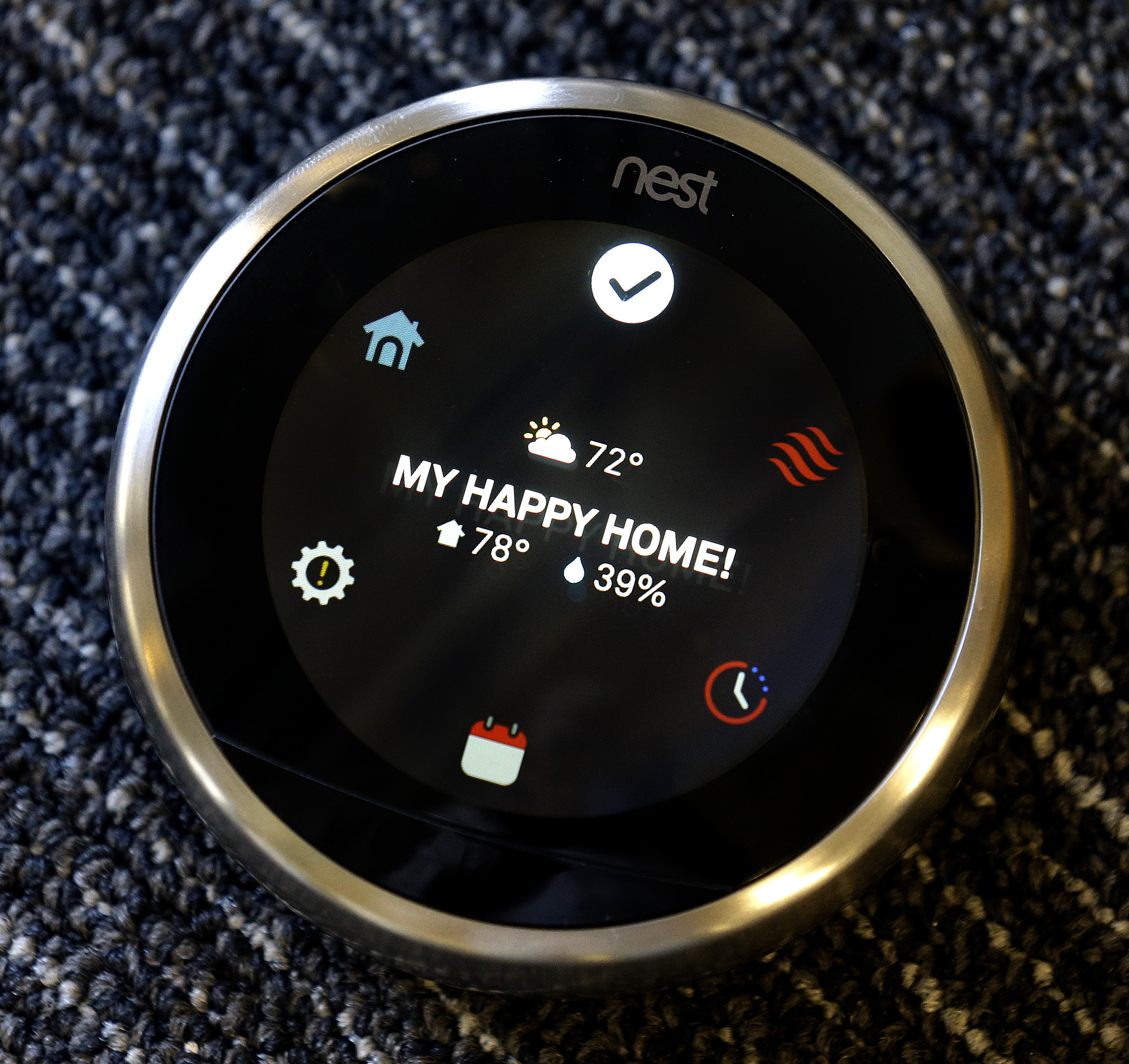 FILE - Nest's Learning Thermostat is shown at Nest Labs in Palo Alto, California, Sept. 10, 2015. The thermostat recognizes when no one is home and turns itself down. (AP)