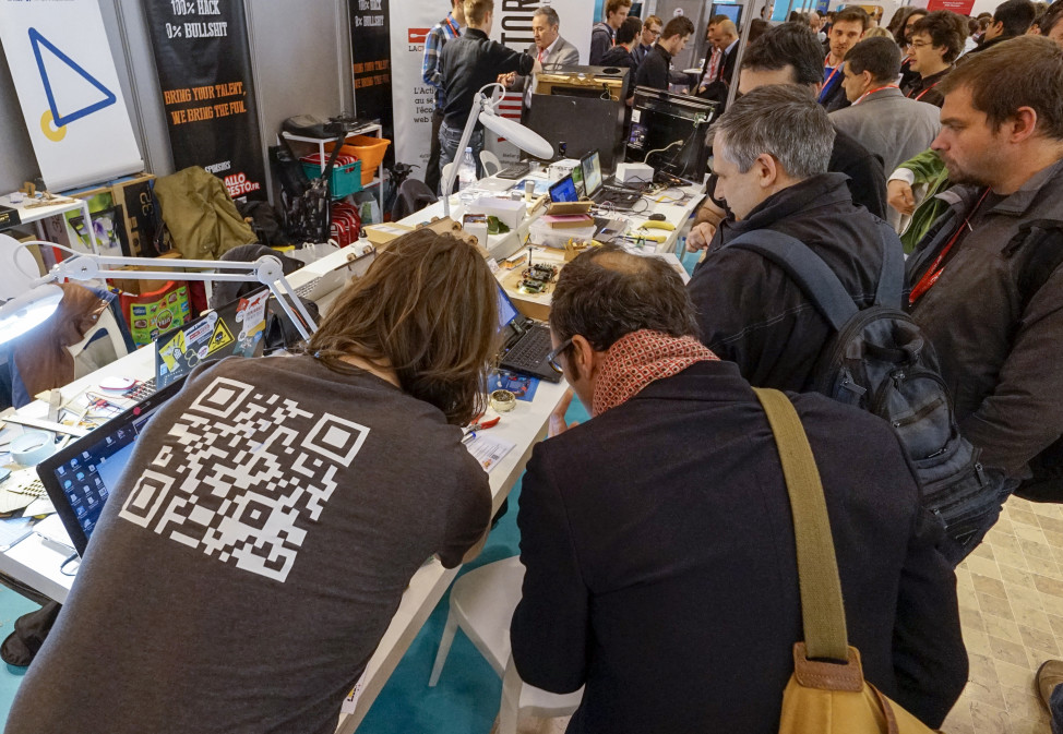 FILE - Visitors at the SIdO Connected Business trade show, an event dedicated to the Internet of Things (IoT), look at displayed products, Lyon, France. (Reuters)