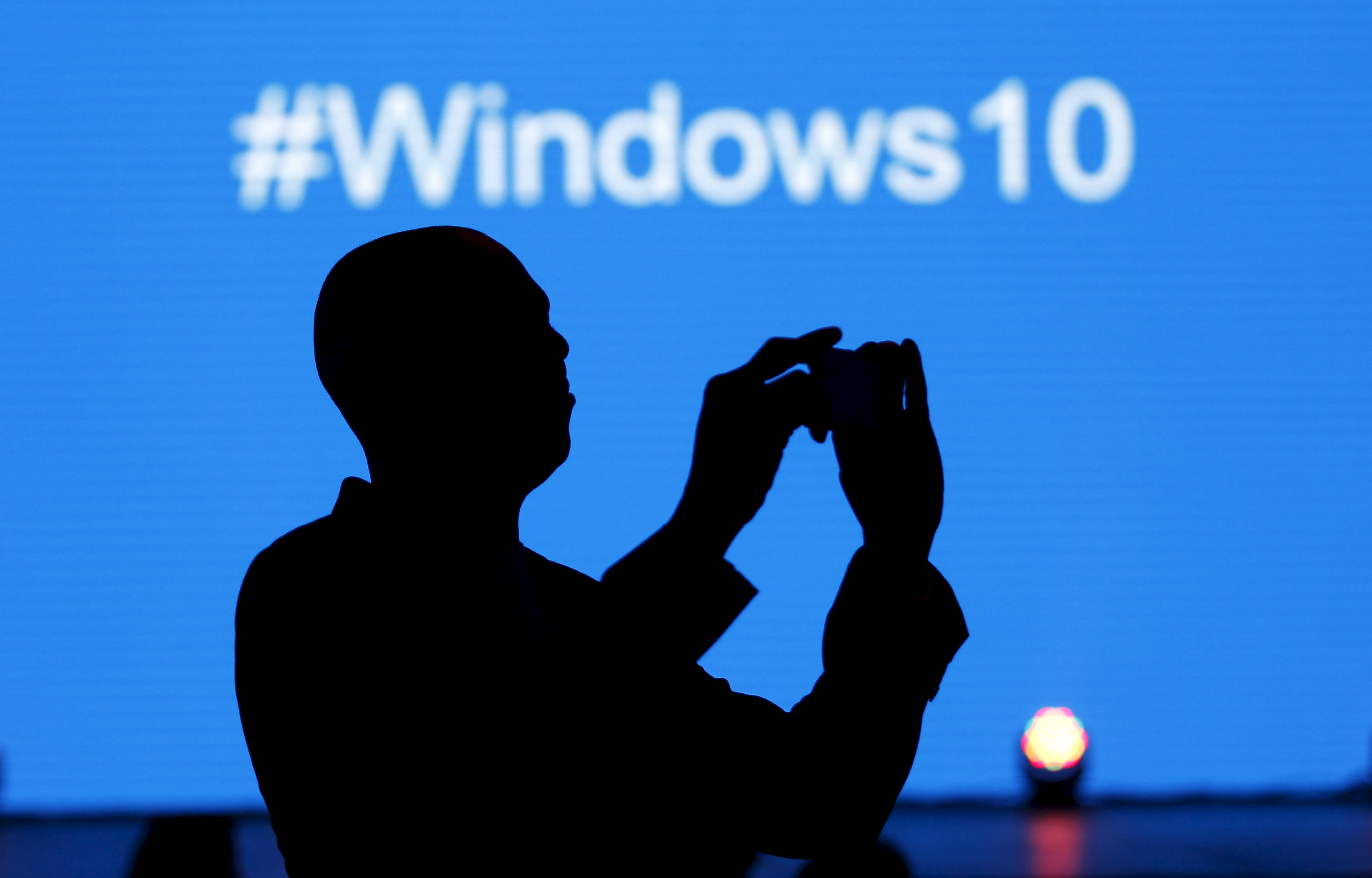 A Microsoft delegate takes a picture during the launch of the Windows 10 operating system in Kenya's capital Nairobi, July 29, 2015. (Reuters)