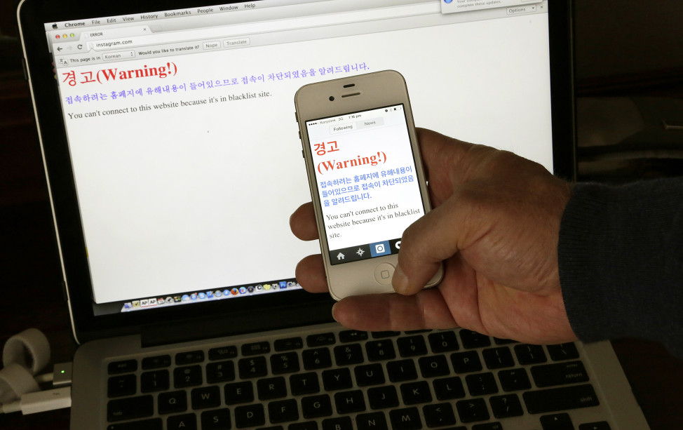 "FILE - A notification saying, ""Warning! You can't connect to this website because it's in blacklist site"" is seen on both a computer screen and on a smartphone screen in Pyongyang, North Korea, June 20, 2015. (AP)"