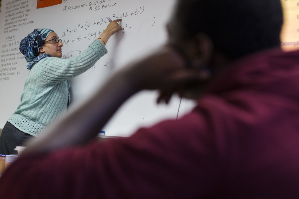 FILE - A Newark Prep Charter School student listens to math teacher Faiza Sheikh give a lesson at the school in Newark, New Jersey. (Reuters)