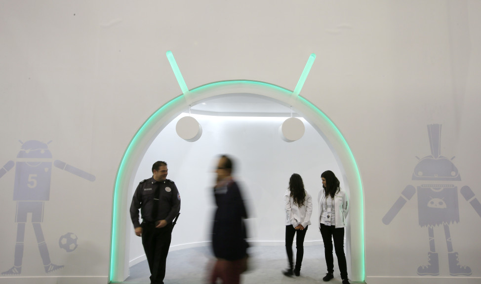 A man walks past the Android entrance stand during the Mobile World Congress in Barcelona, Spain, Feb. 24, 2016.