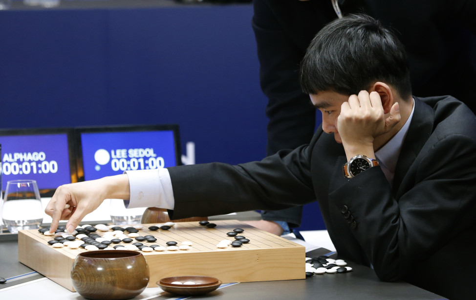 South Korean professional Go player Lee Sedol reviews the match himself after losing the second match of the Google DeepMind Challenge Match to Google's artificial intelligence program, AlphaGo in Seoul, South Korea, March 10, 2016. (AP)