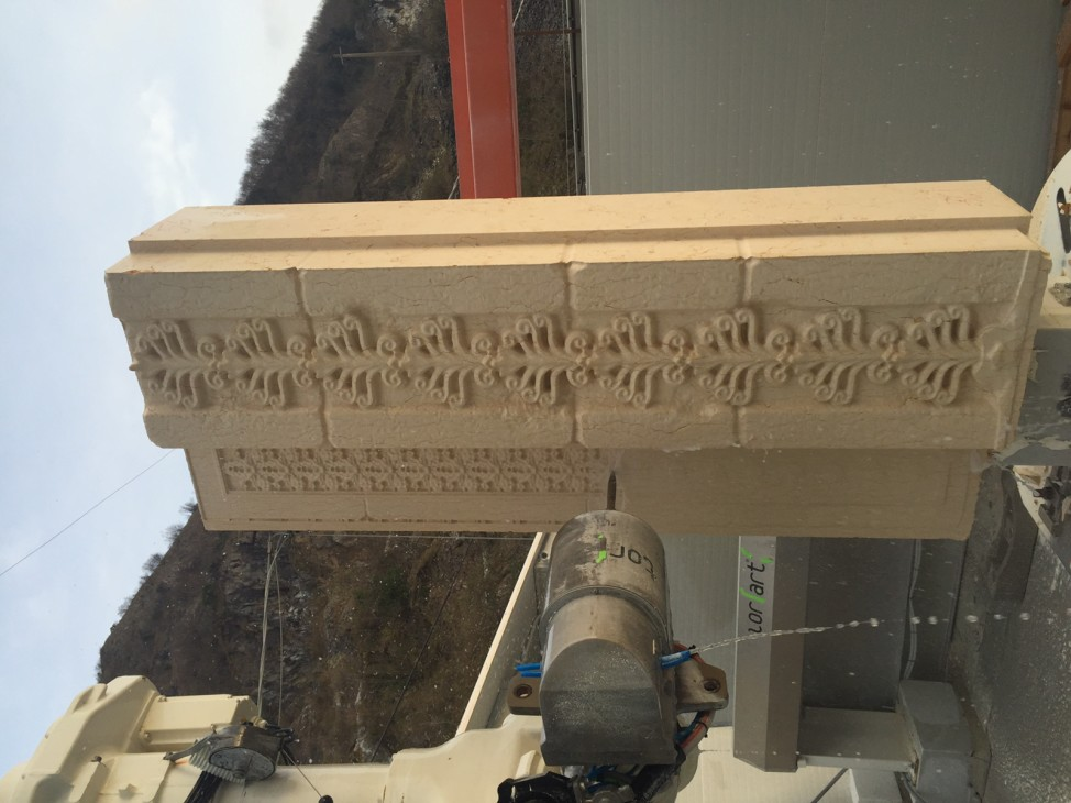 A machine recreates a section of Palmyra's 2000-year-old Triumphal Arch as part of an venture to display the completed replica of the structure in multiple locations around the world on April 19 to mark World Heritage Day 2016. (AP)