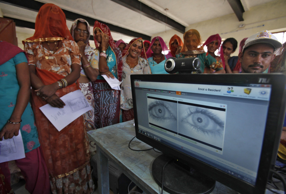 FILE - Village women stand in a queue to get themselves enrolled for the Unique Identification (UID) database system at Merta district in the desert Indian state of Rajasthan. The Indian government has been using the UID database, known as Aadhaar, to make direct cash transfers to the poor.