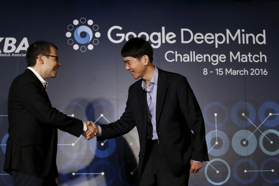 South Korea's Lee Sedol (R), the world's top Go player, shakes hands with Demis Hassabis, CEO of DeepMind Technologies and developer of AlphaGO, after a news conference ahead of matches against Google's artificial intelligence program AlphaGo, in Seoul, South Korea, March 8, 2016. Go is an ancient Chinese board game, where players battle for more ground. (Reuters)