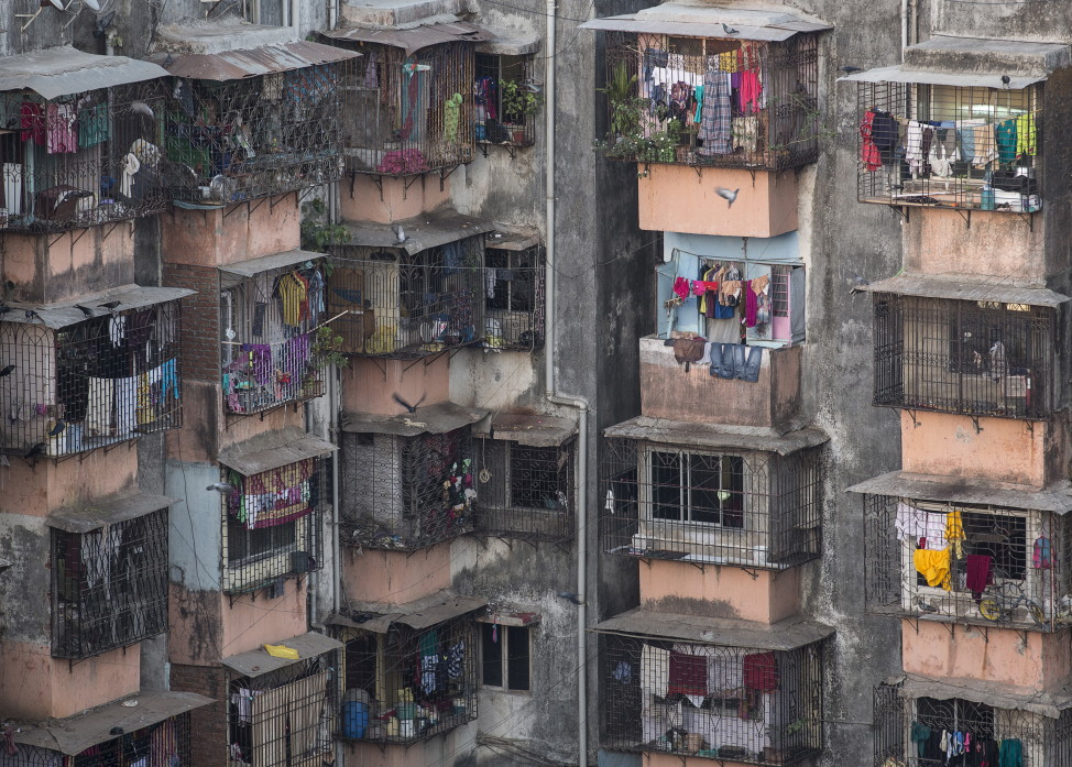 FILE - Windows of various apartments of a residential building are seen in Dharavi, one of Asia's largest slums, in Mumbai, March 18, 2015. (Reuters)