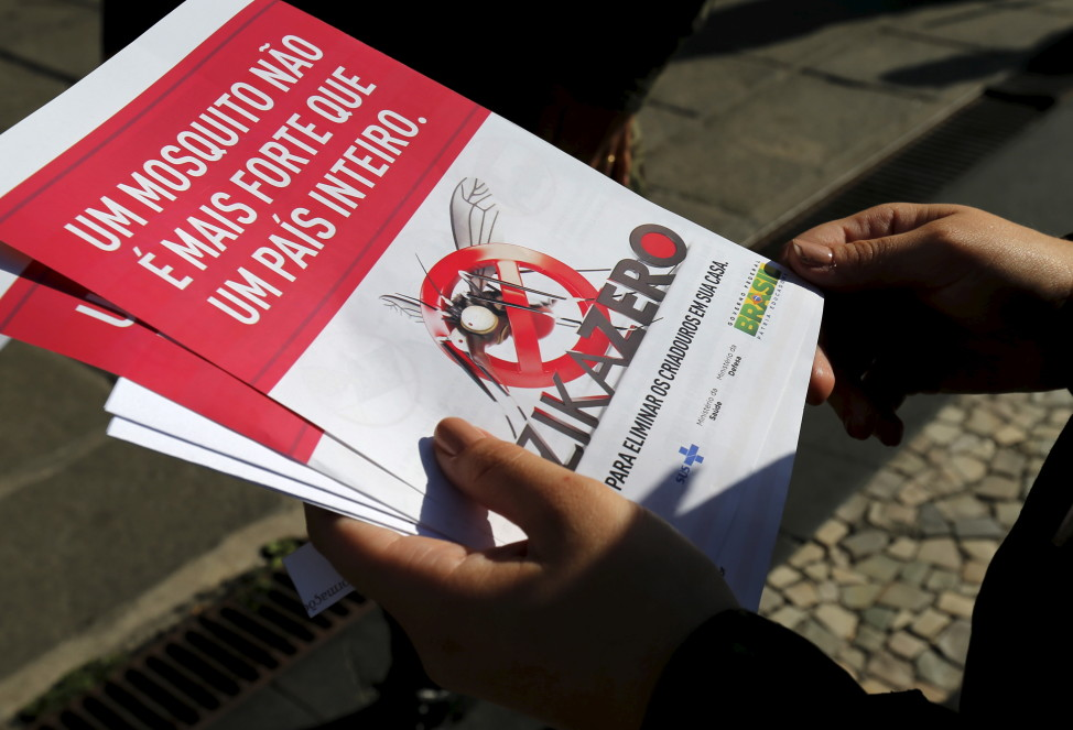 A Brazilian Army soldier shows pamphlets during the National Day of Mobilization Zika Zero in Rio de Janeiro, Brazil, Feb. 13, 2016. The pamphlet reads, 'A mosquito is not stronger than an entire country.' (Reuters)