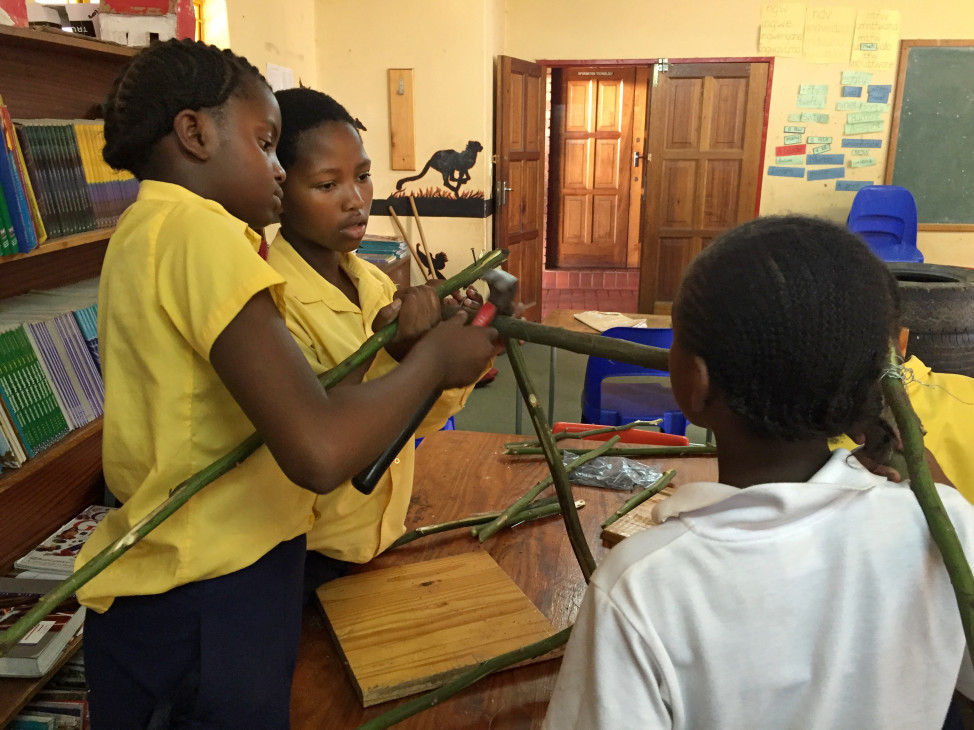 Girls in the 'Design Squad Global Club' at SOS Children's Village school in Mbabane, Swaziland build a waste bin to reduce litter around their school. (WGBH Educational Foundation)