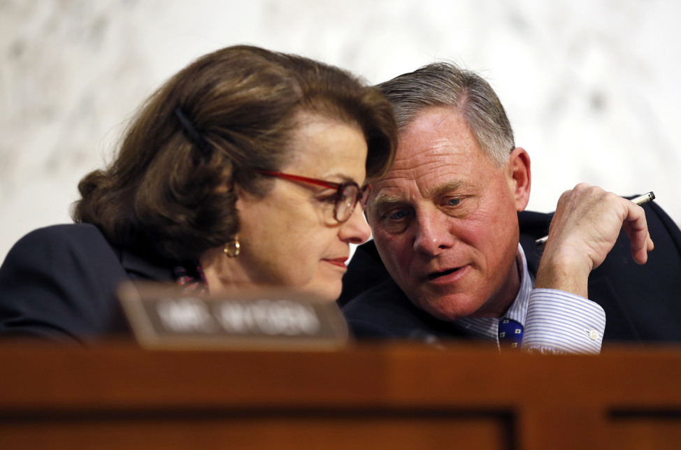 Senate Intelligence Committee Vice Chair Sen. Dianne Feinstein talks with committee chairman Sen. Richard Burr, on Capitol Hill in Washington, Feb. 9, 2016. A draft version of a Senate bill would effectively prohibit unbreakable encryption and require companies to help the government get access to readable data on a device if there's a lawful search warrant. (AP)