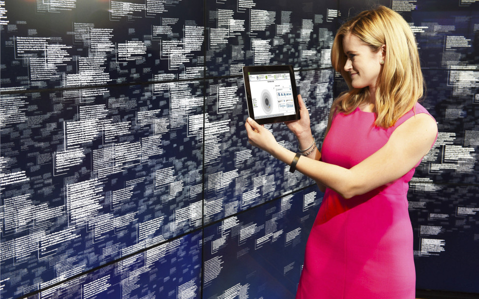 FILE - A photo taken by Feature Photo Service for IBM shows Leanne LeBlanc, IBM Watson project manager, looking at analytics of healthcare data at Watson headquarters in New York City, April 13, 2015. (AP)