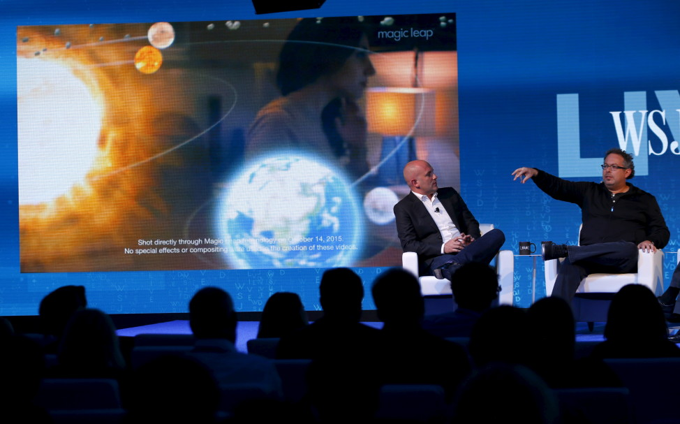 FILE - Rony Abovitz, founder president and CEO of Magic Leap (R) unveils a view of his companies augmented reality with Rio Caraeff, chief content officer, at the Wall Street Journal Digital Live (WSJDLive) conference in Laguna Beach, California  Oct. 20, 2015. (Reuters)