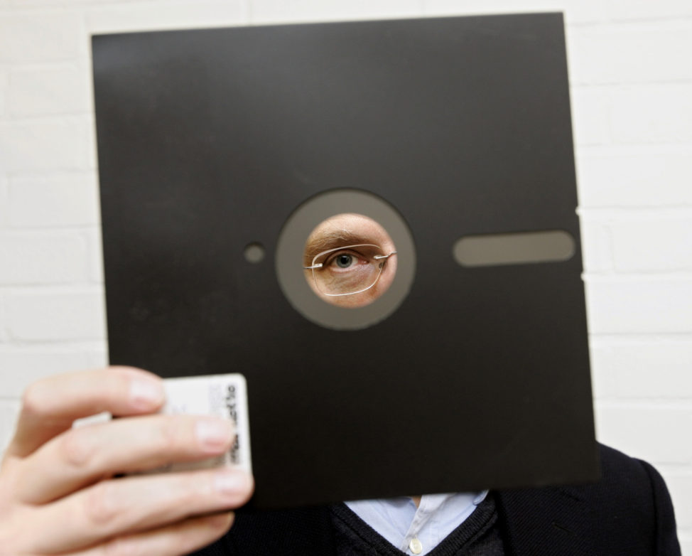 FILE - An obsolete 8 and 1-half inch floppy disc is held in London, England. (AP)