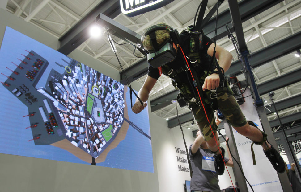 A video game enthusiast experiences the VR virtual reality headset with a skydiving game during the Computex Taipei exhibition at the world trade center in Taipei, Taiwan, May 31, 2016. (AP)
