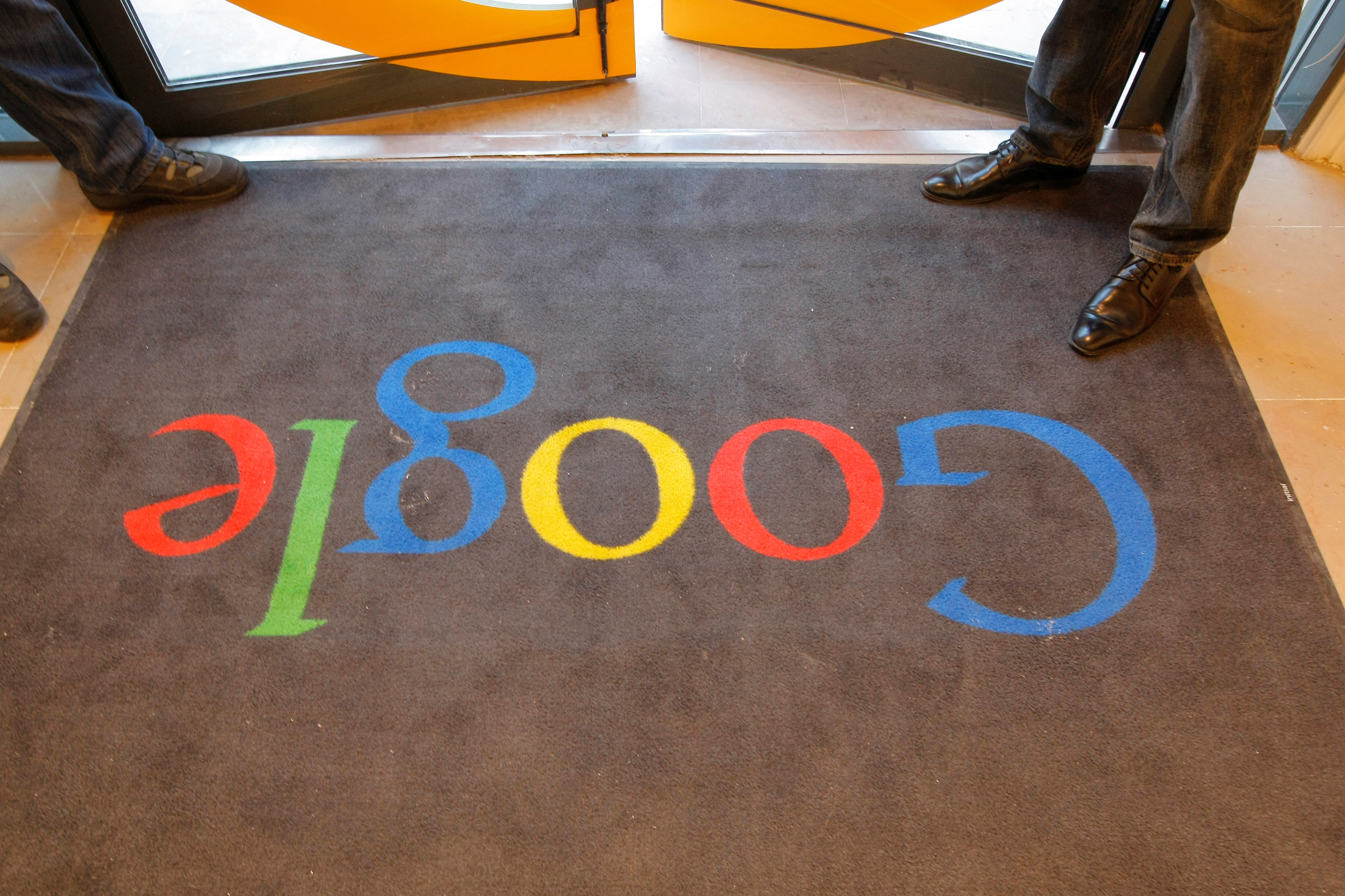 A Google carpet is seen at the entrance of the new headquarters of Google France before its official inauguration in Paris, France, Dec. 6, 2011. (Rueters)