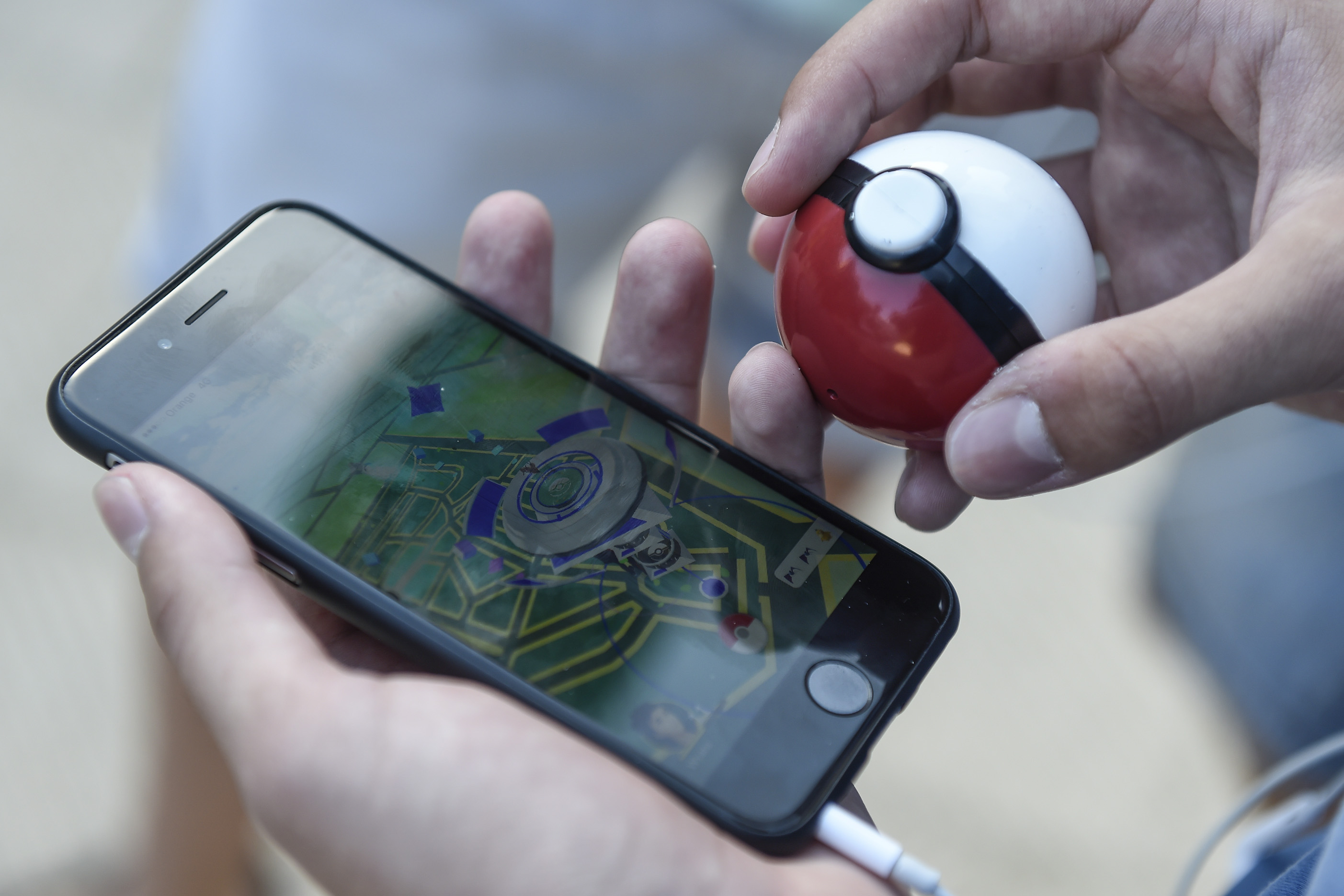 A gamer uses the Pokemon Go application on his mobile phone at a park in Barcelona, Spain, on July 14, 2016. (AFP)