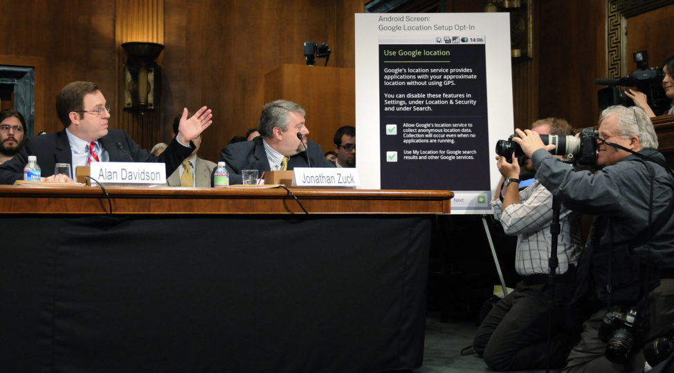 FILE - Google Director of Public Policy Alan Davidson (L) refers to a chart showing how users must opt-in to share location data at a Senate Judiciary Committee hearing titled 'Protecting Mobile Privacy: Your Smartphones, Tablets, Cell Phones and Your Privacy' on Capitol Hill in Washington, May 10, 2011. (Reuters)