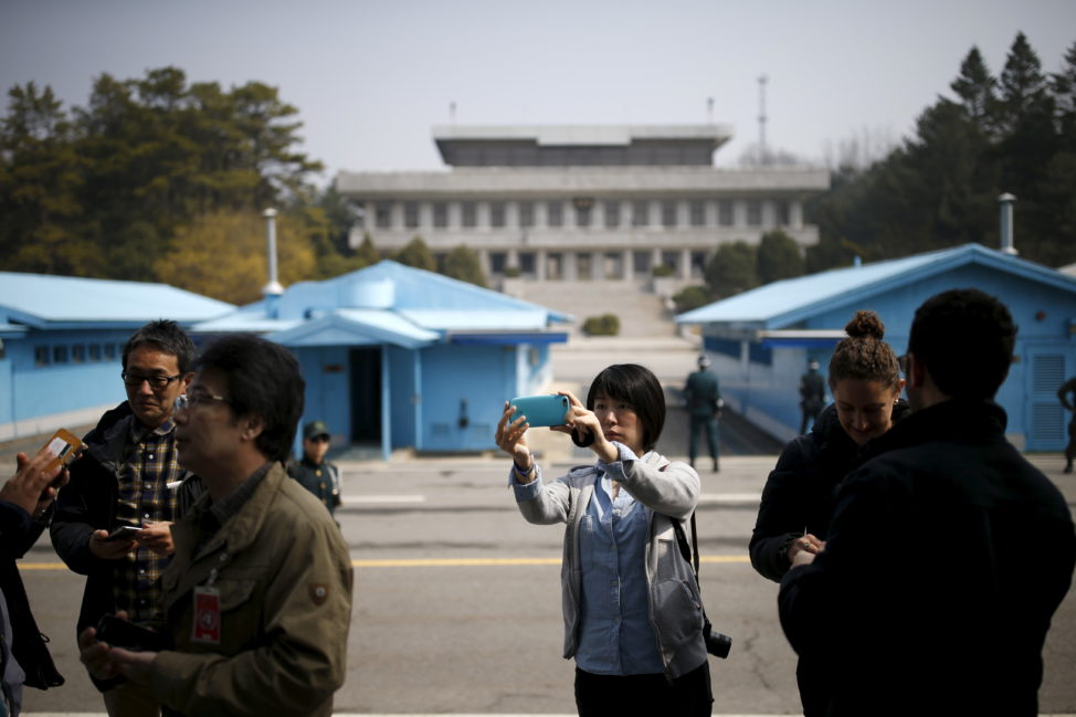 A foreign tourist takes a selfie at the truce village of Panmunjom, South Korea, March 30, 2016. (Reuters)