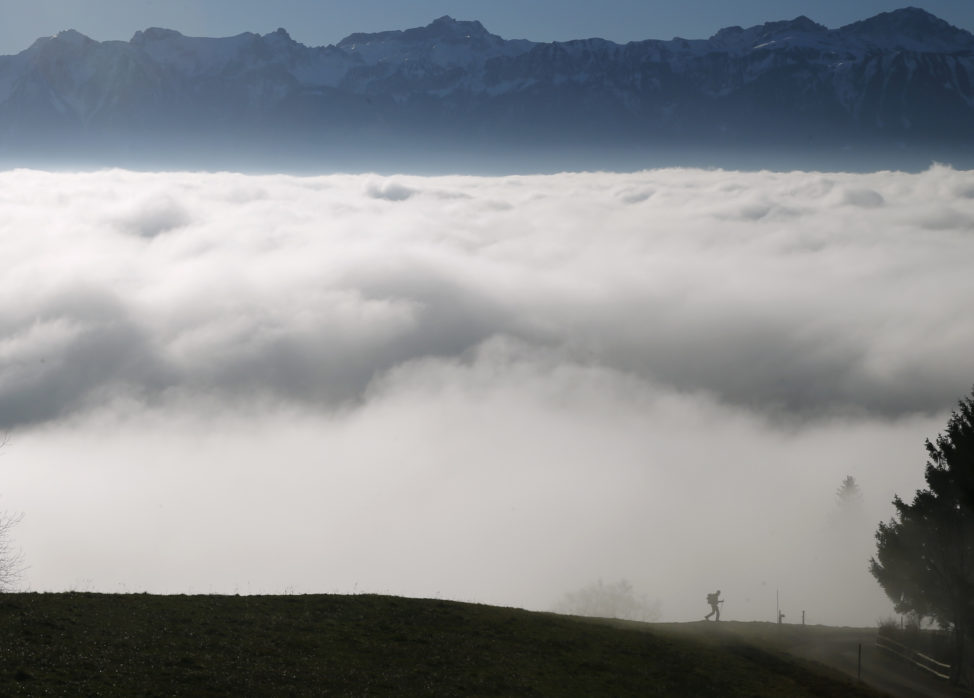 FILE - A hiker walks into a sea of fog over Lake Leman at the Tour de Gourze near Lausanne, Switzerland, Dec. 3, 2015. (Reuters)
