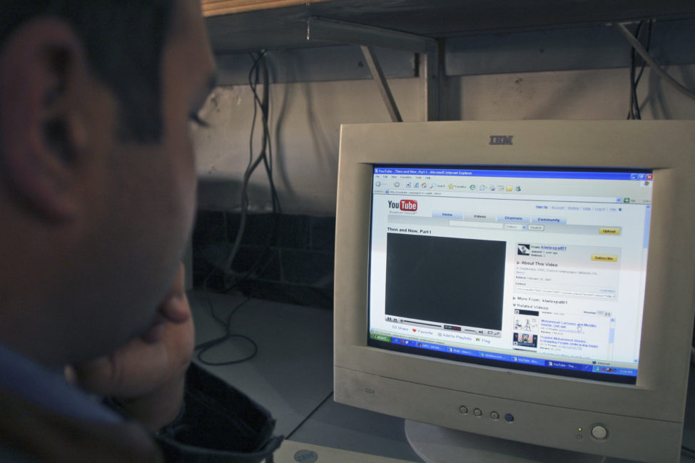 FILE - A Pakistani Internet user surfs the YouTube Web site at a local Internet cafe in Islamabad, Pakistan. (AP)