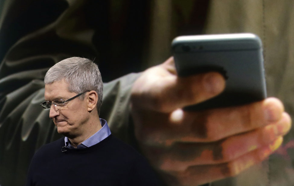 FILE - Apple CEO Tim Cook speaks at an event to announce new products at Apple headquarters in Cupertino, California, March 21, 2016. (AP)