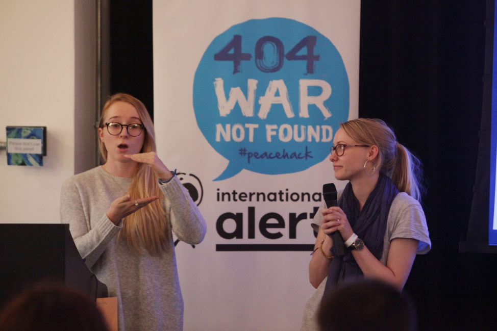 The winning team pitch their plugin, 'Hate Speech Blocker,' during the Peacehack 2016 hackathon in London, England. (International Alert)
