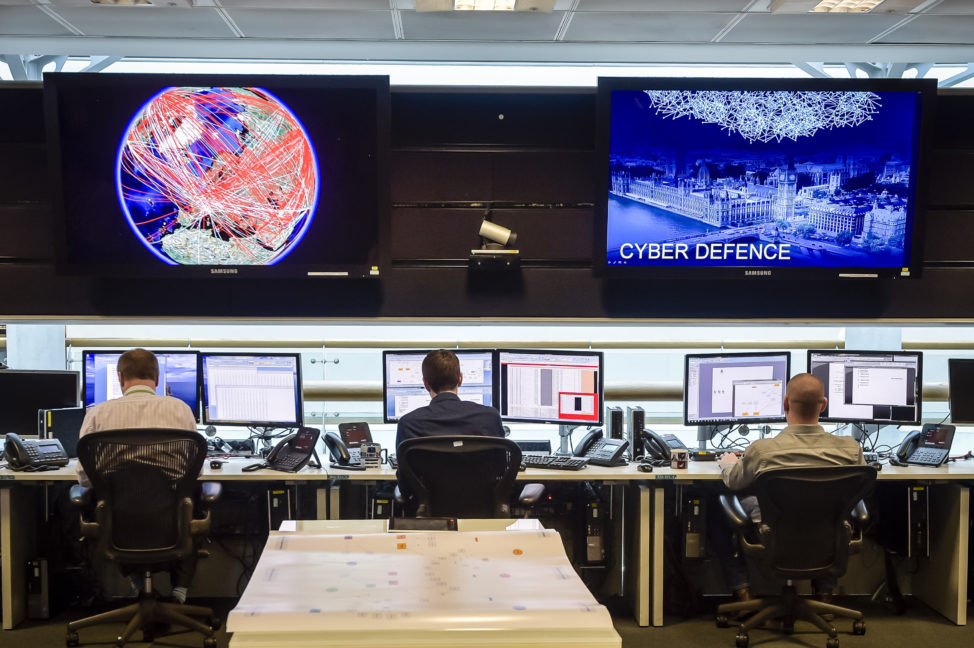 People sit at computers in the 24- hour Operations Room inside GCHQ, Cheltenham in Cheltenham, UK, Nov. 17, 2015.