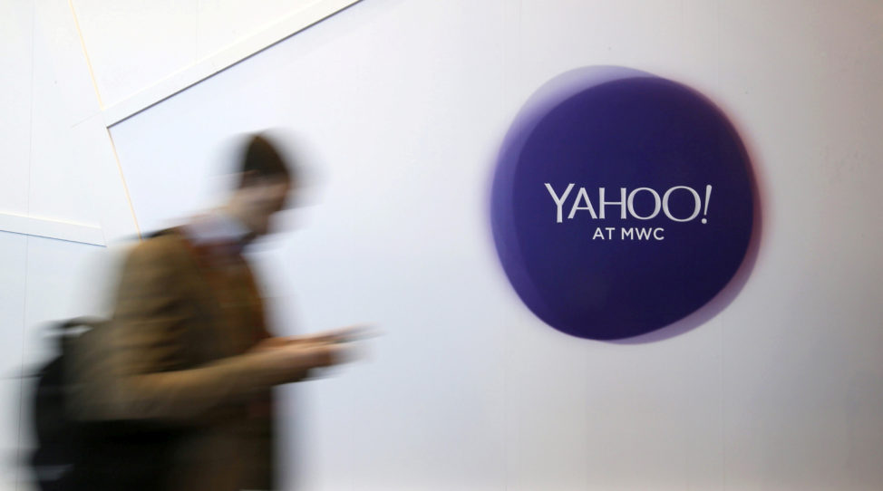 FILE - A man walks past a Yahoo logo in Barcelona, Spain. (Reuters)