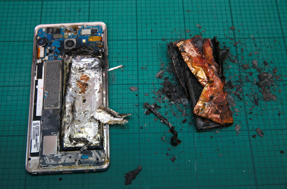 A Samsung Note 7 handset is pictured next to its charred battery after catching fire during a test at the Applied Energy Hub battery laboratory in Singapore Oct. 5, 2016. (Reuters)